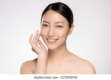 Beautiful smiling woman with clean skin, natural make-up, and white teeth on white background