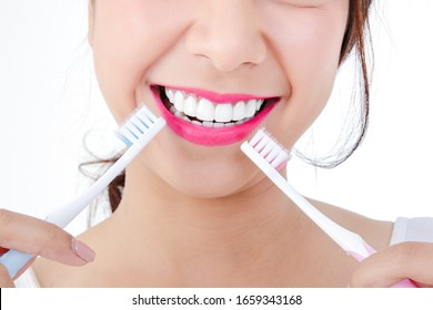 Beautiful smiling woman, clean white teeth, pink lips, hold a toothbrush. Oral care concept. White background
