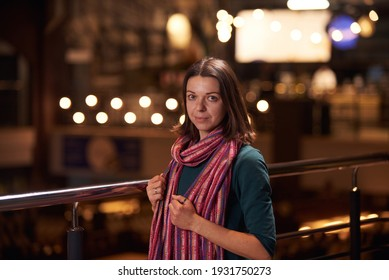 Beautiful smiling woman drinking coffee at cafe. Pretty woman with cup of coffee.