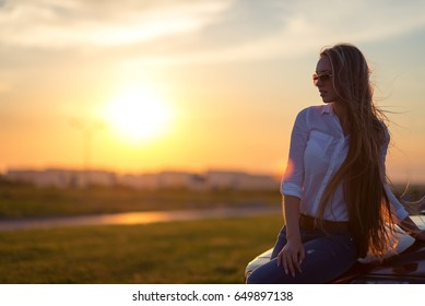 Beautiful Smiling woman driving car, attractive girl sitting in automobile, outdoors summer portrait.
