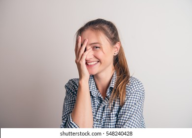 Beautiful smiling woman, with hand on face