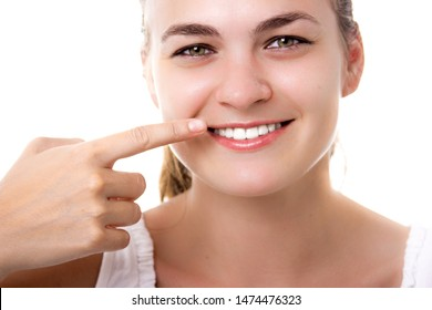 Beautiful smiling woman with healthy teeth, all natural