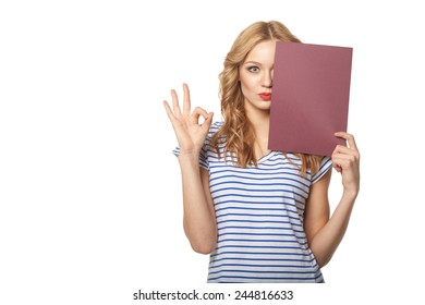 Beautiful smiling woman holding a blank billboard, isolated on a white background