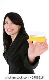 Beautiful smiling woman holding a membership card, bank or credit card, business card etc.