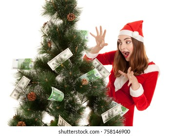 Beautiful smiling woman with money fir tree