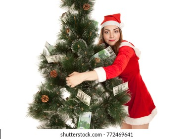 Beautiful smiling woman in new year costume hugging money fir tree