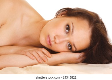Beautiful smiling woman on bed at bedroom