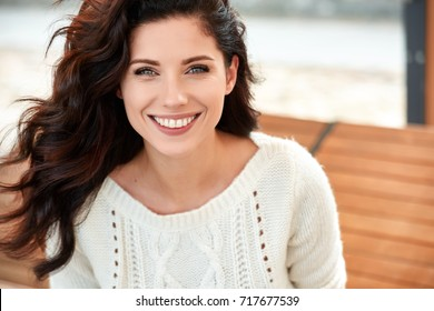 beautiful smiling woman in the park