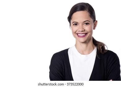 Beautiful smiling woman posing over white in studio