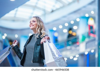 Beautiful smiling woman in a store