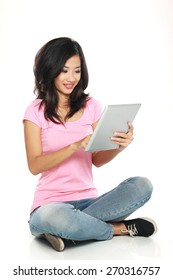 Beautiful smiling woman with tablet PC sitting on the floor