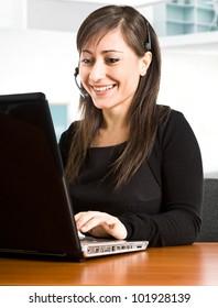 Beautiful smiling woman using a computer