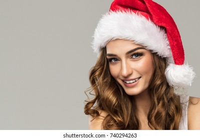 Beautiful smiling woman wear santa claus hat