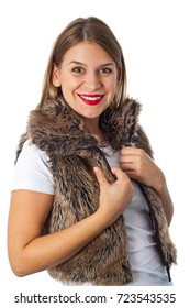 Beautiful smiling woman wearing a fur vest smiling at the camera on isolated background