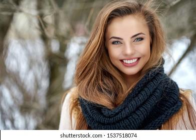 Beautiful smiling woman winter portrait