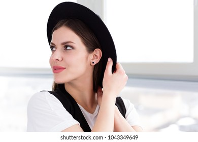 Beautiful smiling woman with a wool hat in a studio