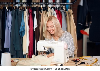 beautiful smiling woman working on the sewing machine at workplace. close up photo. lifestyle, free time, spare time