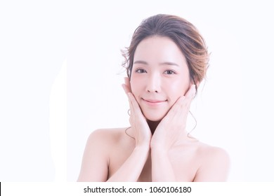 Beautiful Smiling Young Asian Woman with Clean, Fresh, Glow, and pefect Skin. Beauty and skincare Spa concept. Isolated over white. Happy, healthy, cheerful, lovely girl on white background.