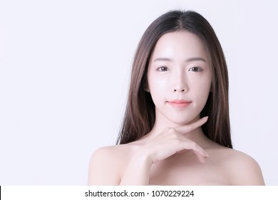 Beautiful Smiling Young Asian Woman with Clean, Fresh, Glow, and pefect Skin. Happy, healthy, cheerful, relaxing asian girl on white background, studio shot.
