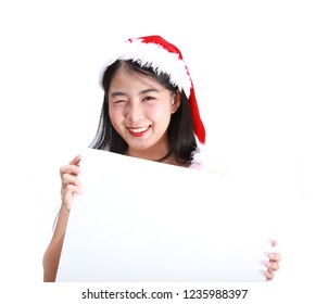 Beautiful smiling young asian woman with blank white board isolated on white background