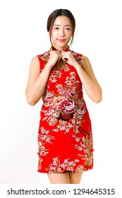 Beautiful Smiling Young Asian Woman in red cheongsam dress, chinese new year concept. Asian cheerful, lovely woman in chinese dress traditional cheongsam.Chinese woman wear qipao for chinese new year.