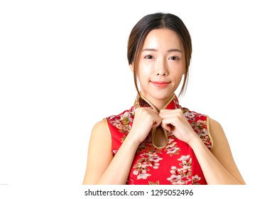 Beautiful Smiling Young Asian Woman in red cheongsam dress, chinese new year concept. Asian cheerful, lovely woman in chinese dress traditional cheongsam.