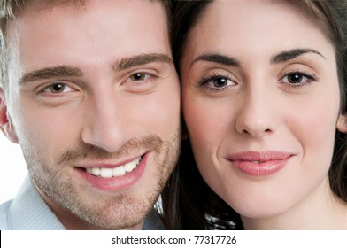 Beautiful smiling young couple closeup faces