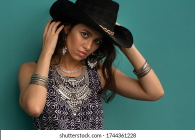 Beautiful smiling young south girl boho style clothing and jewelry