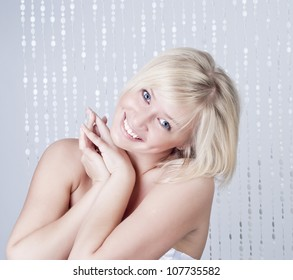 Beautiful smiling young woman with blond hair, portrait