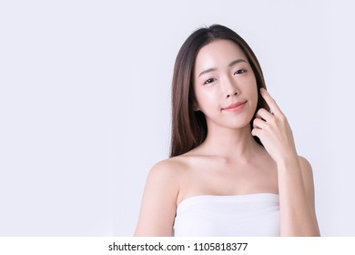 Beautiful Smiling Young Woman with Clean, Fresh, Glow, and pefect Skin. Beauty and skincare Spa concept. Isolated over white.