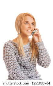 Beautiful smiling young woman in gray sweater talking on a mobile phone, isolated on white background.