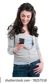 Beautiful smiling young woman holding a smart phone while text messaging isolated on white background