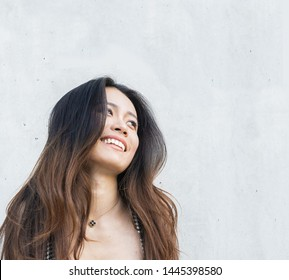 Beautiful smiling young woman looking to side
