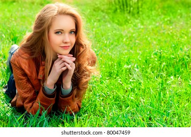 Beautiful smiling young woman outdoors.