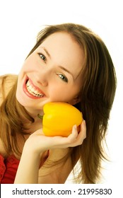 beautiful smiling young woman with a pepper isolated against white background