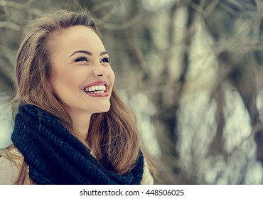 Beautiful smiling young woman portrait - close up