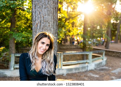 Beautiful and smiling young woman released from marriages after her recent divorce smiles looking for new couples dating.