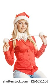 Beautiful smiling young woman in Santa Claus hat and red shirt, isolated on white background.