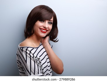 Beautiful smiling young woman with short hair style on blue background