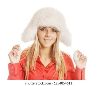 Beautiful smiling young woman in white fur hat and red shirt, isolated on white background.