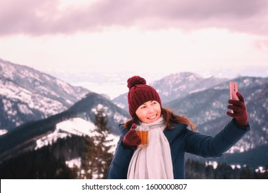Beautiful smiling young woman in winter mountains at sunset, outdoor travel background, happy winter concept. Jasna ski resort, Low Tatras, Slovakia (Slovensko)