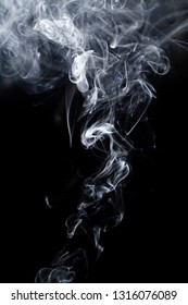 Beautiful smoke on the black background - macro photo
