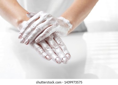 Beautiful and smooth hand skin. The woman puts a mask on the skin of the hand. Hand skin care.