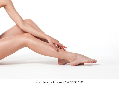 Beautiful smooth legs of young woman close-up. Skin Care and Health Concept