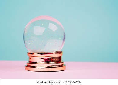 Beautiful snow ball on pink over blue pastel background.