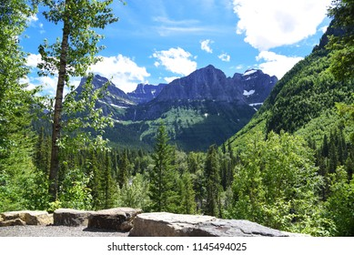 The beautiful snow covered mountain peaks surrounded by dense green pine forest in the Glacier National Park,Montana,USA