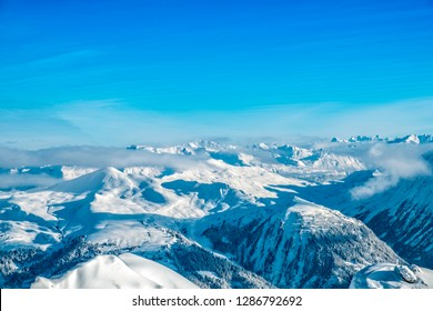 Beautiful snow covered mountains of the Arosa skiing region in Switzerland