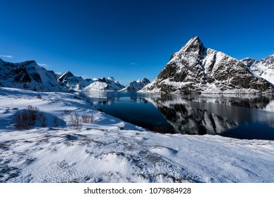 Beautiful snow covered mountains of the Lofoten Islands.  Reine, Norway