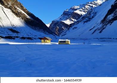 Beautiful Snow Covered Mountains Zojila Pass, Two Small Huts, Nature Scenery Himalayas, Leh Ladakh, Jammu and Kashmir, India. October 2015