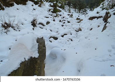 Beautiful Snow Covered Rocks Between Mountains, Winters, Khajjiar Road, Himachal Pradesh, India.